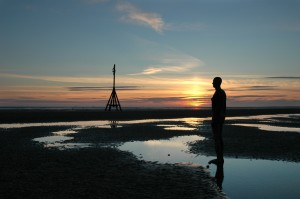 Gormley statue sunset